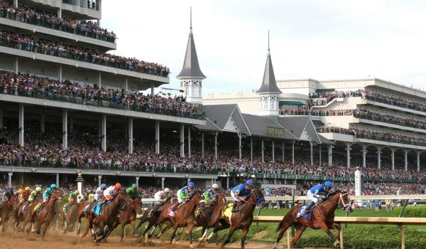Horses rounding a turn in the Kentucky Derby race